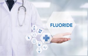 Dentist with fluoride